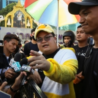 Protest leaders Parit 'Penguin' Chiwarak and Panupong 'Mike Rayong' Jadnok speak to the media at a pro-democracy rally in Bangkok on Wednesday.  | REUTERS