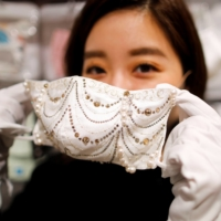 Fighting coronavirus in luxurious style with ¥1 million masks