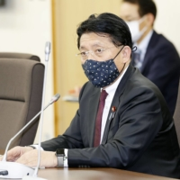Takuya Hirai, minister in charge of digitalization, speaks Thursday in Tokyo at a task force meeting to prepare for the creation of the digital agency. | KYODO