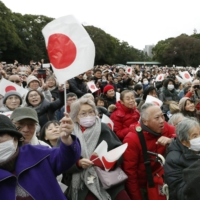 People gather at the Imperial Palace in Tokyo on Jan. 2 to see Emperor Naruhito and his family to greet the public at New Year. | KYODO