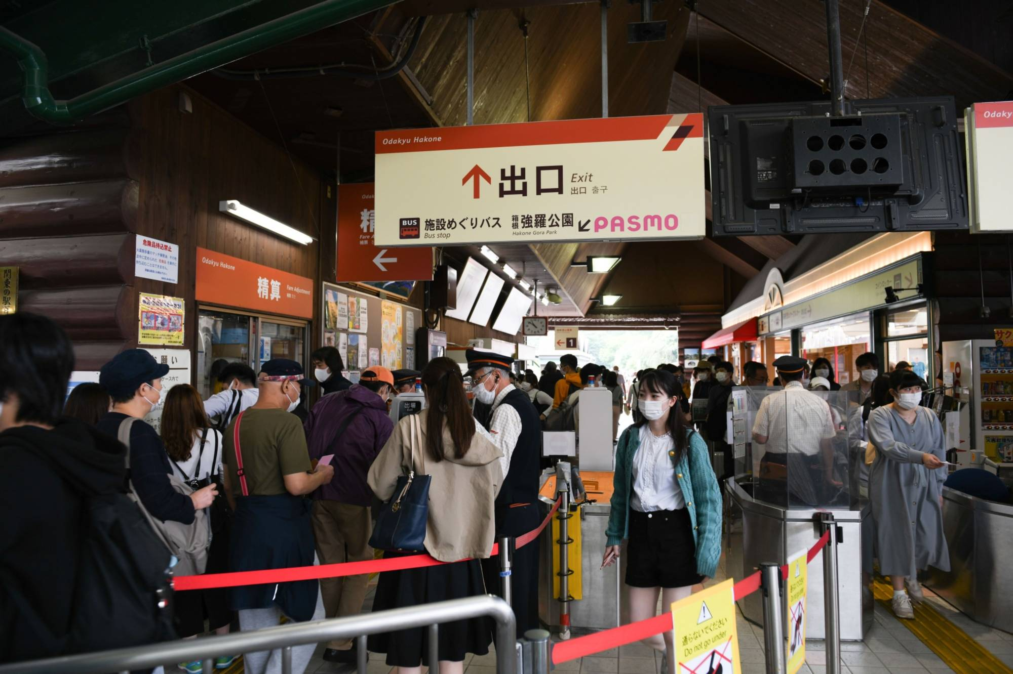 Passengers go through ticket gates at Gora Station in Hakone, Kanagawa Prefecture, on Oct. 4. | BLOOMBERG