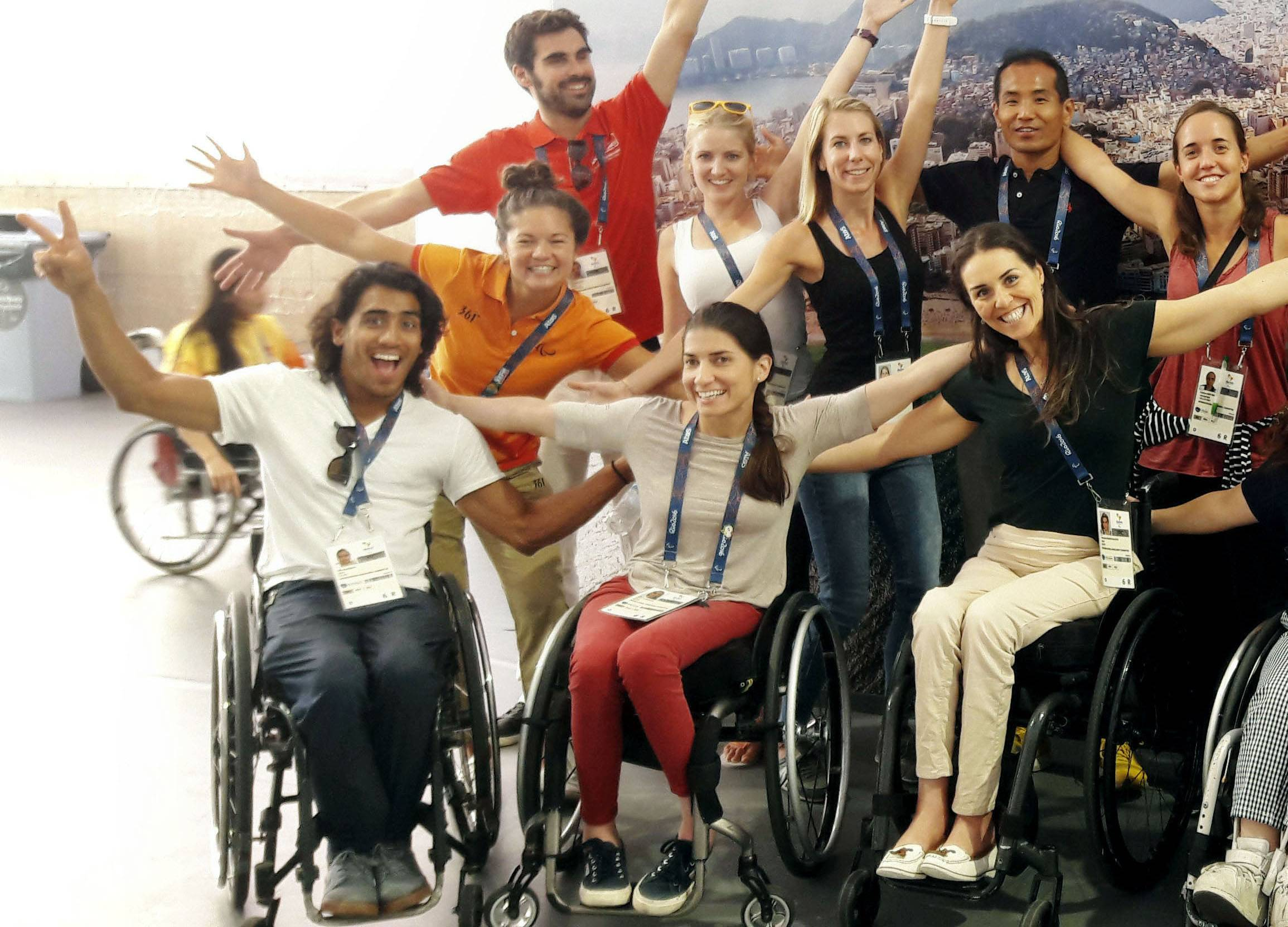 Ileana Rodriguez (seated, center) poses with other staffers of the International Paralympic Committee during the 2016 Summer Paralympics in Rio de Janeiro in September 2016. | ILEANA RODRIGUEZ / VIA KYODO