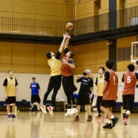 Ryan Rossiter (center, left) and Gavin Edwards compete during a jump ball during a national team practice at the National Training Center on Nov. 19. | JBA
