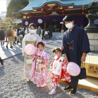 A family visits Hie Shrine in Chiyoda Ward in Tokyo on Nov. 15 for a festival celebrating children of 3, 5 and 7 years of age. | KYODO