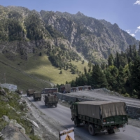 An Indian army convoy moves on a highway northeast of Srinagar in Indian-controlled Kashmir. This year, China's military built up forces in the Himalayas and crossed into territory that India claimed was on its side of the de facto border.  | AP
