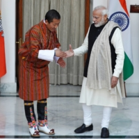 Bhutan's Prime Minister Lotay Tshering and his Indian counterpart Narendra Modi shake hands ahead of their meeting at Hyderabad House in New Delhi in December 2018. Over the past year, China has moved aggressively against many of its neighbors, seemingly with little regard for diplomatic or geopolitical fallout.  | REUTERS