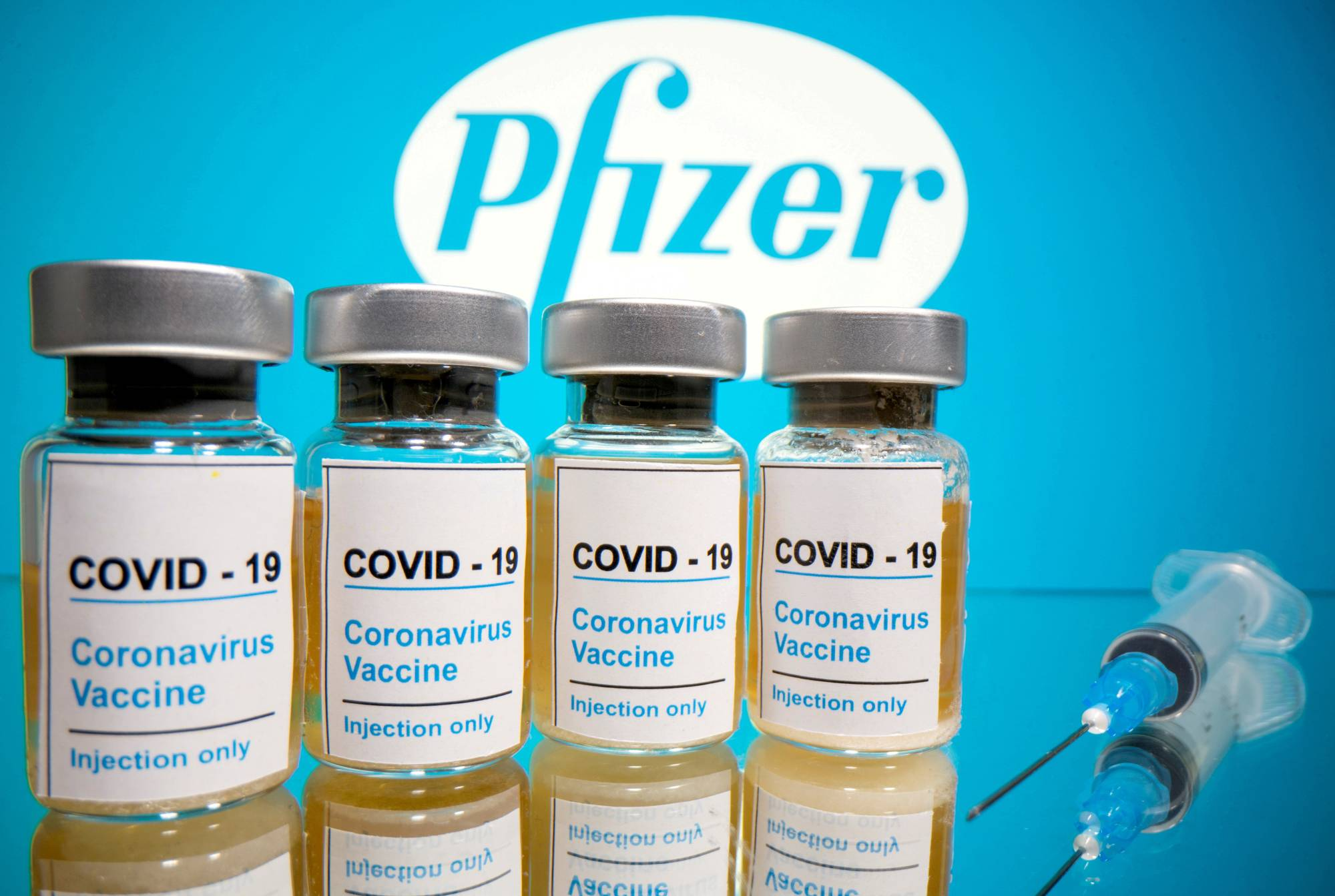 The COVID-19 vaccine made by Pfizer Inc. and BioNTech SE could see approval in the U.K. within days.  | REUTERS