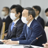 Prime Minister Yoshihide Suga speaks at a government task force meeting on coronavirus measures at the Prime Minister's Office on Friday. | KYODO