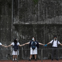 Students form a human chain in Hong Kong in September 2019.  | REUTERS