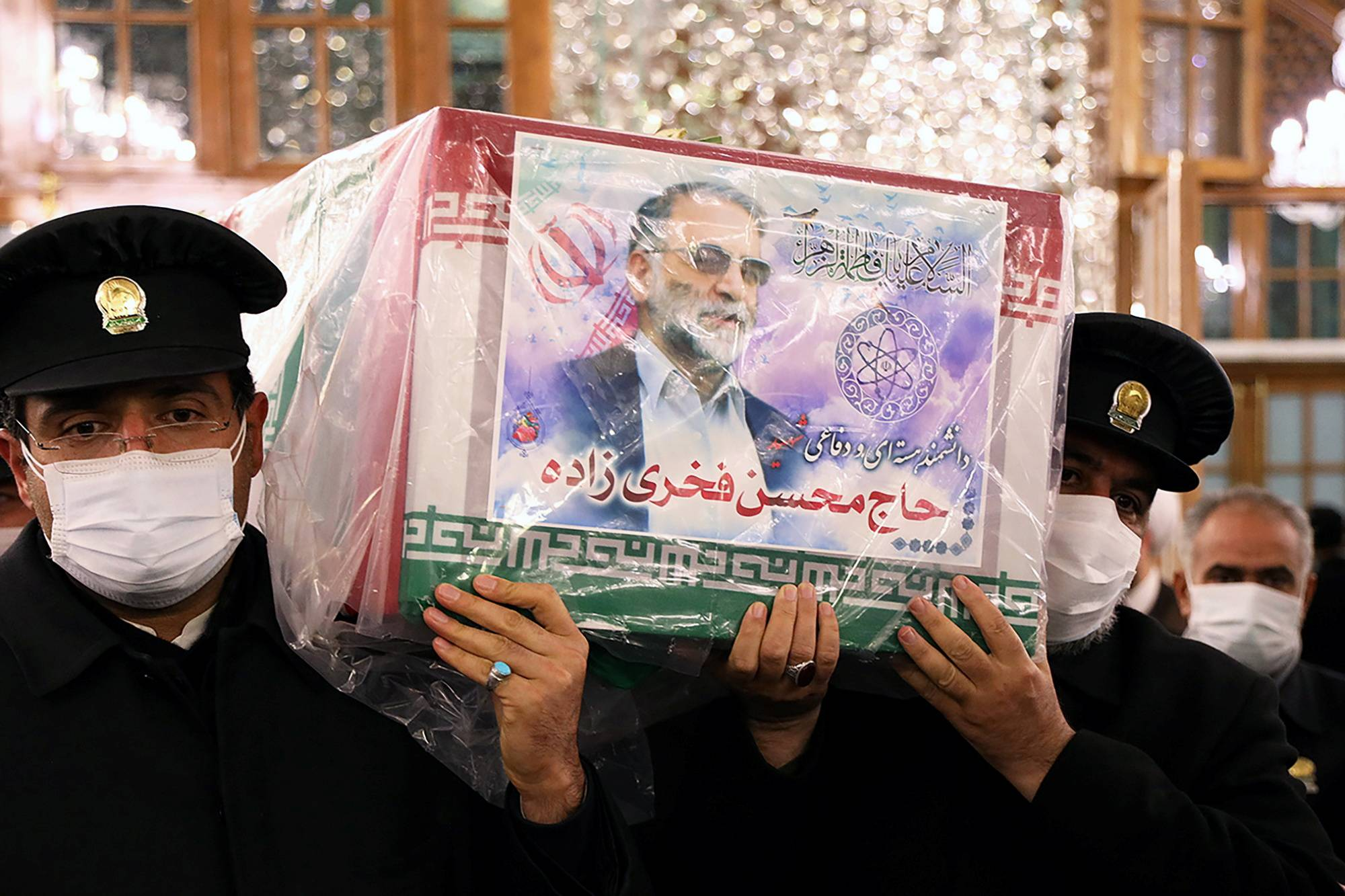 Mohsen Fakhrizadeh, whose coffin is seen being carried here in Mashhad, Iran, on Sunday, was sometimes described as Iran's Robert Oppenheimer, the scientist at the center of America's pioneering nuclear weapons project in the 1940s. | WEST ASIA NEWS AGENCY / VIA REUTERS
