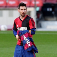 Lionel Messi wears a Newell's Old Boys shirt to pay homage to Diego Maradona after scoring for Barcelona on Sunday. | REUTERS