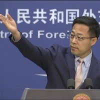 Chinese foreign ministry spokesperson Zhao Lijian gestures during a news briefing in Beijing on Nov. 23. | AP