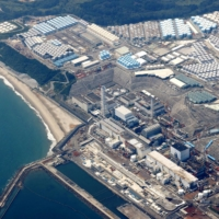 Tanks with radioactive water are piled up at Fukushima No. 1 nuclear power plant in October, which Tepco hopes to release into the sea in an apparent effort to make room to store fuel debris from reactors. | KYODO