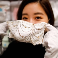 Cox Co.'s luxury face mask features diamond, platinum and Swarovski crystals, and sells for ¥1 million. | REUTERS