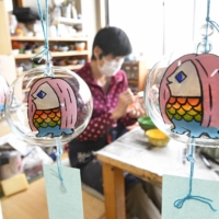 A variety of goods bearing amabie designs, such as decorative wind chimes, have been produced in Japan in recent months. | KYODO