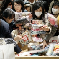 What's the deal?: Shoppers grab lucky bags at Hanshin department store in Osaka last year.  | KYODO