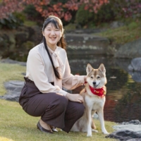 Princess Aiko poses with her dog Yuri at Akasaka Estate in Tokyo on Nov. 22 ahead of her 19th birthday on Tuesday. | IMPERIAL HOUSEHOLD AGENCY / VIA KYODO