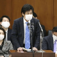 Prepare for the worst, Japan health minister says, as virus cases surge