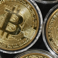 Bitcoin won't be viewed as an existential threat to the banking system just because its price is soaring. Rather it will be seen as a spur toward a more digital, regulator-friendly post-COVID payments future. | AFP-JIJI