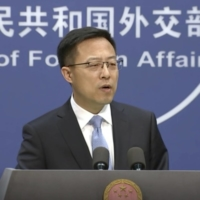 Chinese Foreign Ministry spokesperson Zhao Lijian speaks at a briefing in Beijing on Nov. 17.  | AP