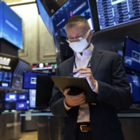 A trader on the trading floor at the New York Stock Exchange on Tuesday.  | NEW YORK STOCK EXCHANGE / VIA AP
