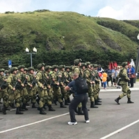 A photo provided by a local resident of Etorofu island in the Northern Territories shows Russian soldiers marching on the island on Sept. 3 to commemorate the 75th anniversary of the victory against Japan in World War II. | KYODO