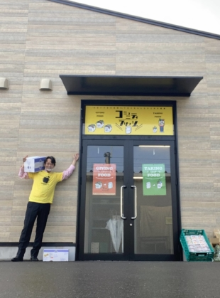 Food support: Kenichi Narita stands in front of the recently opened Kitanagase Community Fridge in Okayama, the first such community fridge in Japan. | COURTESY OF KENICHI NARITA
