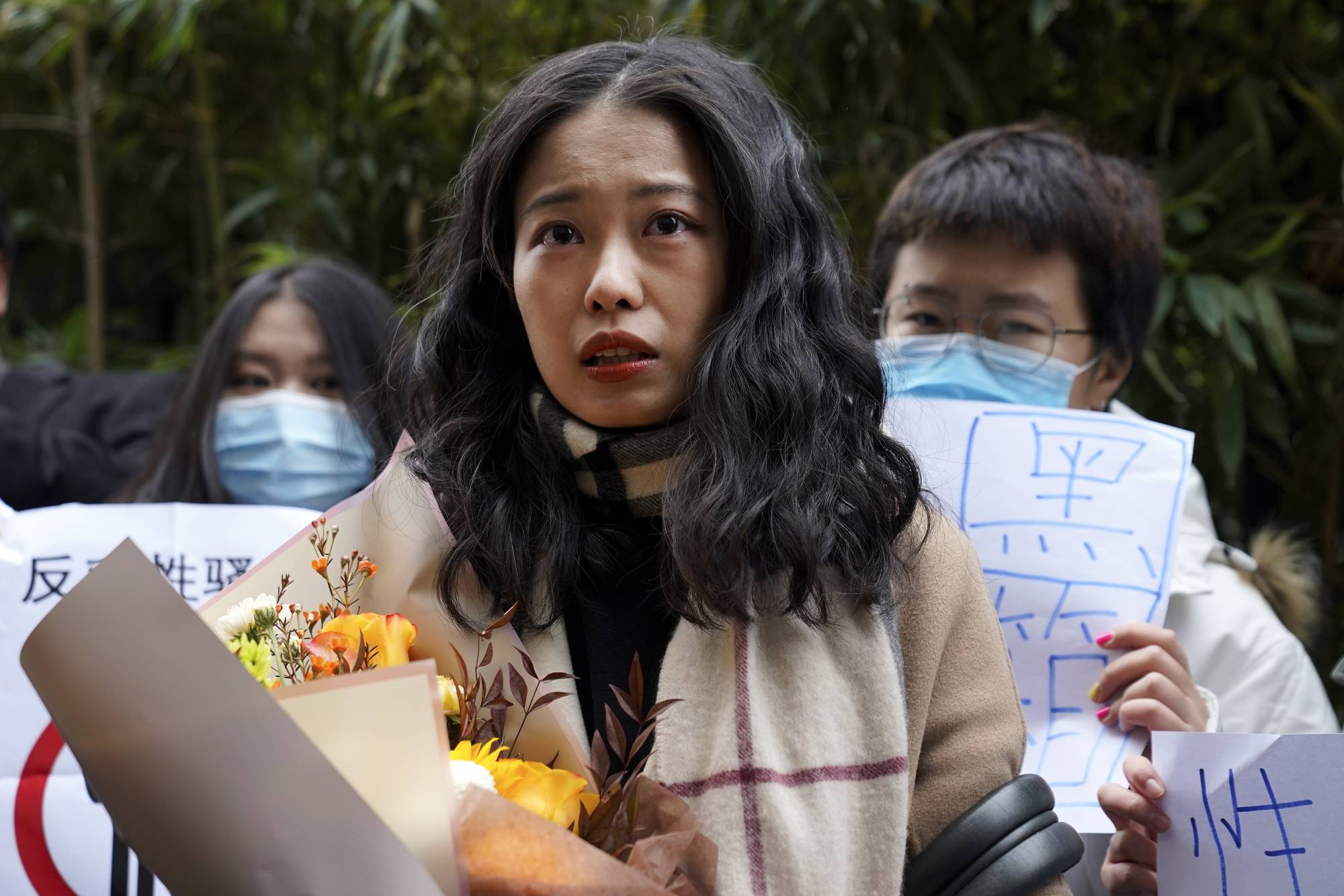 Zhou Xiaoxuan speaks to supporters as she arrives at a courthouse in Beijing on Wednesday. | AP