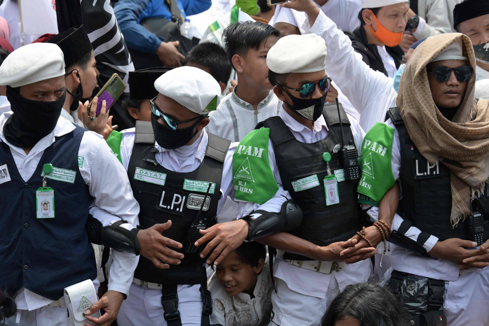 Supporters of Rizieq Shihab, leader of the Islamic Defenders Front, gather at the organization's headquarters in Jakarta on Nov. 10. | AFP-JIJI