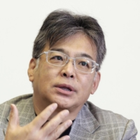 Fujitsu Ltd. President Takahito Tokita will take a 50% pay cut for four months as a result of the Oct. 1 shutdown of the Tokyo Stock Exchange. | KYODO
