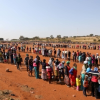 While South Africa has struggled with COVID-19, seeing more than 20,000 deaths to date, it also must struggle with rampant poverty, which has led many requiring food aid. | REUTERS