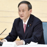Prime Minister Yoshihide Suga called for the international community to realize a 'united world.' | KYODO