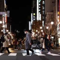 People walk in Sapporo's Susukino district in November. Recovery in business sentiment started slowing down in the month, with Hokkaido seeing its diffusion index deteriorate for the first time in six months, Teikoku Databank Ltd. said. | KYODO