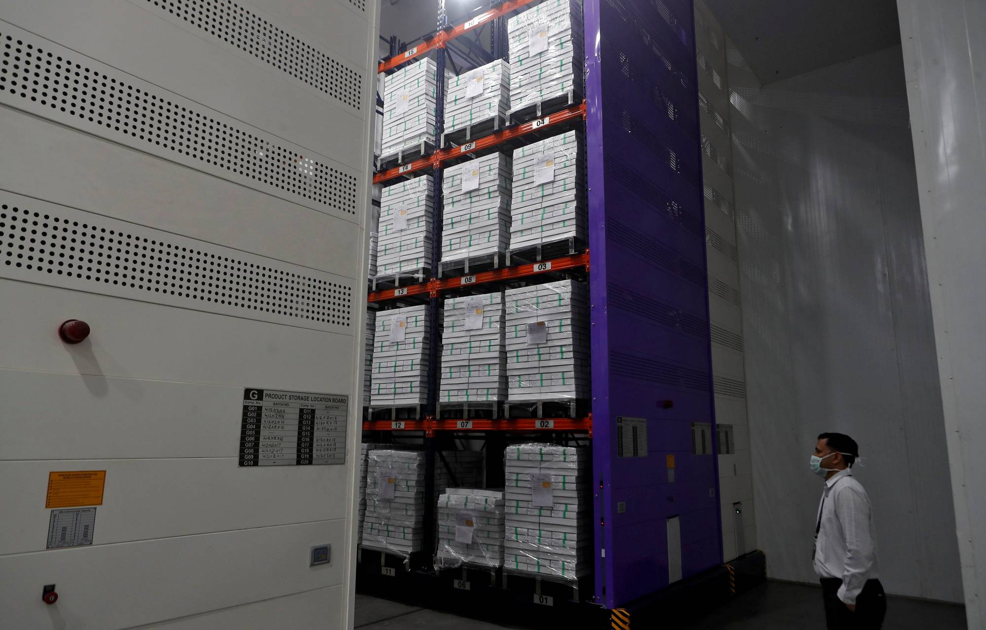 Boxes containing the vials of AstraZeneca's COVID-19 vaccine at an institute in Pune, India. | REUTERS