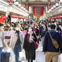 Asakusa's Nakamise shopping street in Tokyo was crowded with people a week earlier. | KYODO