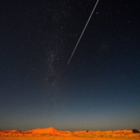 The Hayabusa2 probe's sample drops to Earth after landing on and gathering material from an asteroid some 300 million km away, in Coober Pedy, Australia, on Sunday. | AFP-JIJI