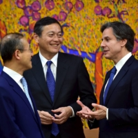 U.S. Deputy Secretary of State Antony Blinken (right) chats with Japanese Foreign Minister Akitaka Saiki (center), and South Korea's Vice Foreign Minister, Lim Sung-nam, before a meeting in Seoul in April 2016.   POOL / VIA REUTERS