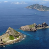Japan, France and the United States will hold their first joint military drills on one of Japan's uninhabited outlying islands to counter China, a report says. | KYODO / VIA REUTERS