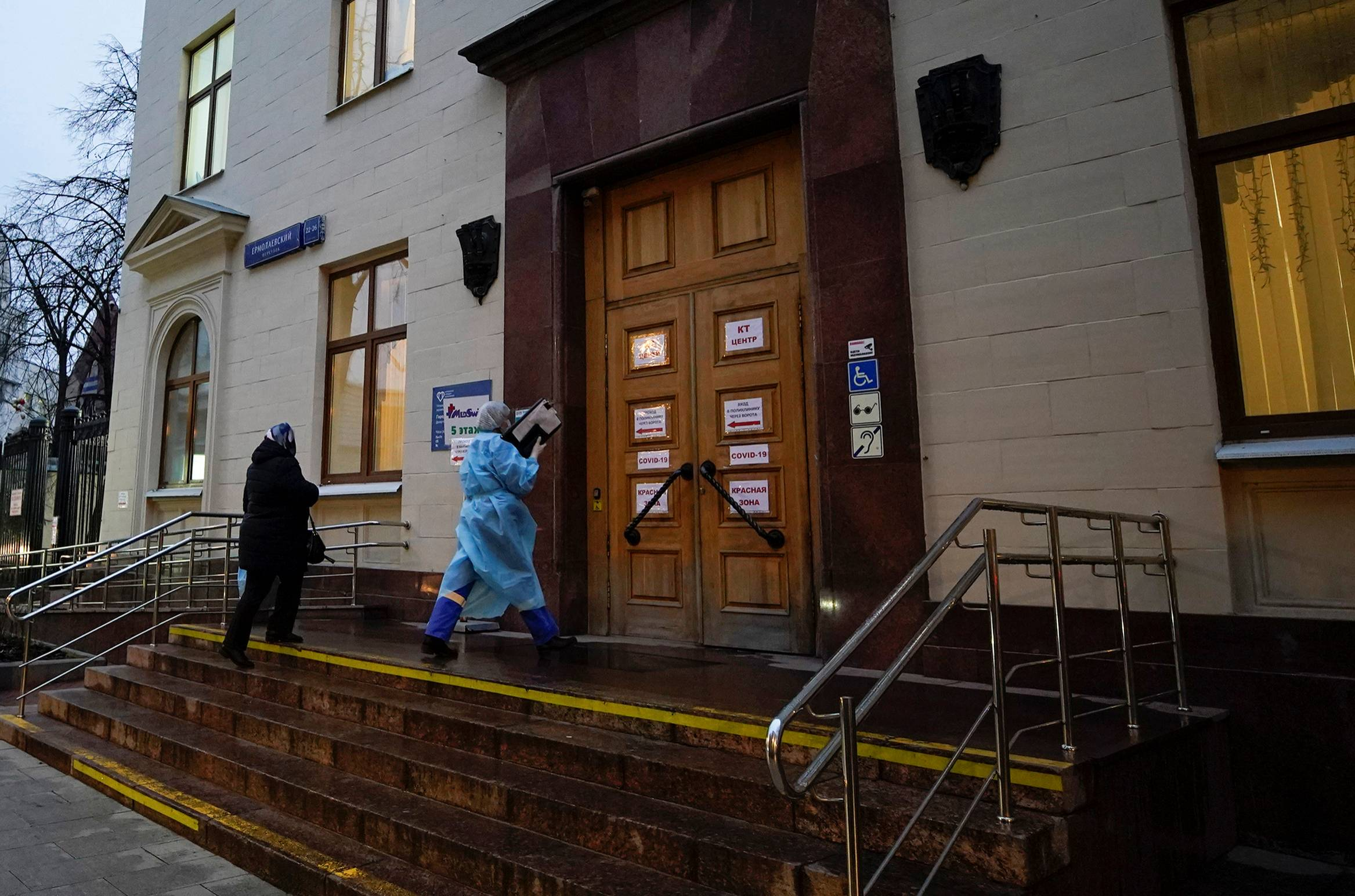 A medical specialist enters City Polyclinic Number 3 in Moscow. | REUTERS