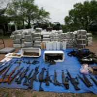Packs of marijuana, weapons and other items are displayed after an operation against drug hitmen by Mexican soldiers at a ranch near the municipality of Sabinas Hidalgo in 2010. Unheard of years ago, Chinese players are now regularly routing cartel drug profits from the United States to China then on to Mexico with a few clicks of a burner phone and Chinese banking apps | REUTERS