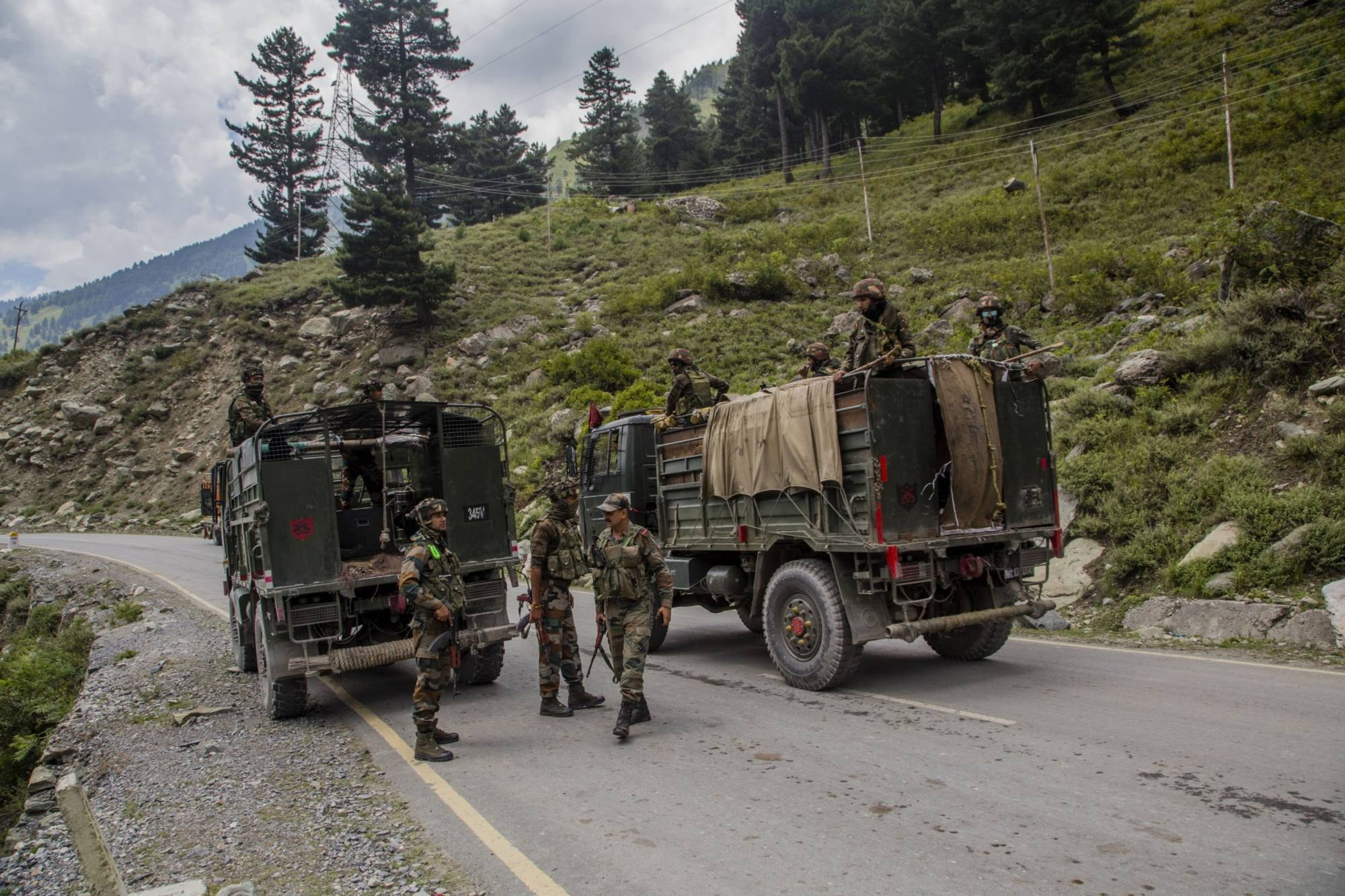 An Indian army convoy on a highway bordering China | BLOOMBERG