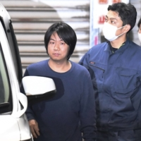 Man arrested over alleged burial of missing Tokyo woman's body