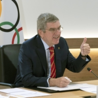 IOC President Thomas Bach speaks during a news conference on Monday in Lausanne, Switzerland. | HANDOUT / VIA GETTY / VIA KYODO