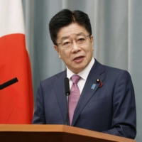Chief Cabinet Secretary Katsunobu Kato speaks at a news conference in Tokyo on Tuesday. | KYODO