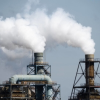 Japan's greenhouse gas emissions fell to a record low in fiscal 2019. | BLOOMBERG