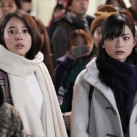 Celebrate with a bang: Alice Hirose (left) and Kayano are among the crowds of onlookers lured to Shibuya by news of a bomb scare in 'Silent Tokyo.' | © 2020 SILENT TOKYO FILM PARTNERS