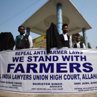 Members of the All India lawyers union take part in a protest in support of the nationwide general strike called by farmers against recent agricultural reforms, in Allahabad on Tuesday.   | AFP-JIJI