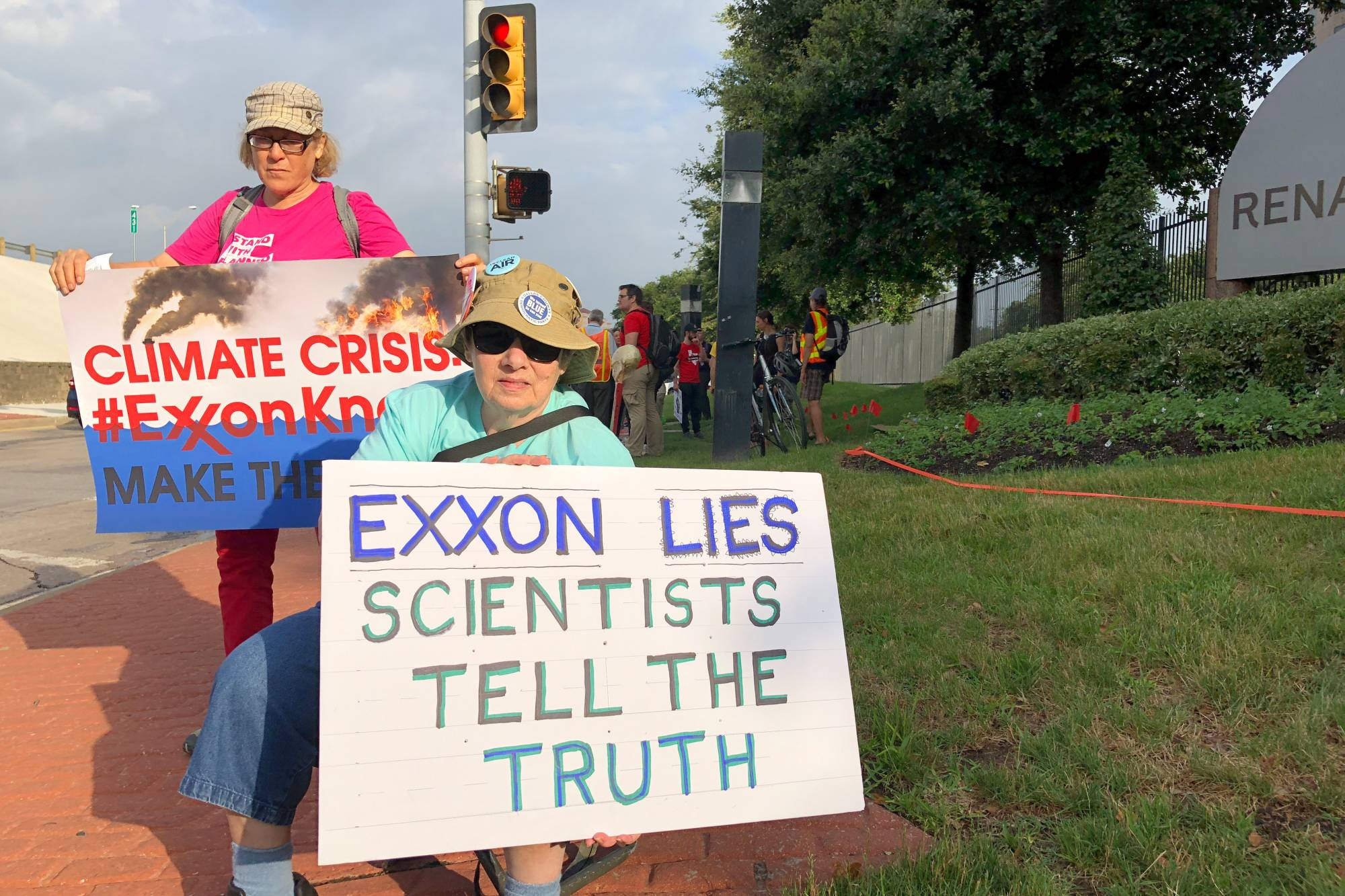 Activists protest against Exxon's climate change policies at the ExxonMobil's 2019 annual shareholders meeting in Dallas, Texas, in May 2019.  | REUTERS