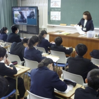 Junior high school students attend a mathematics class in Hiroshima in December 2019. Less than 30% of second-year junior high school students said they want to work in a profession that uses math or science, which is about half of the international average, according to an international survey. | KYODO