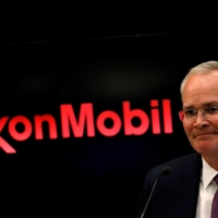 Darren Woods, chairman and CEO of Exxon Mobil Corp., holds a news conference in New York in 2017.  | REUTERS